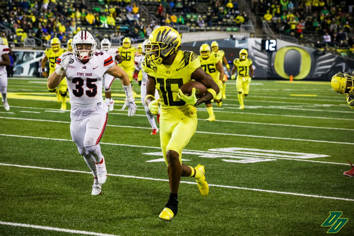 Thornton runs for a touchdown against Stony Brook on his first college reception.