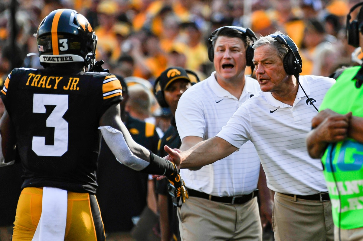 Sep 18, 2021; Iowa City, Iowa, USA; Iowa Hawkeyes head coach Kirk Ferentz reacts with wide receiver Tyrone Tracy Jr. (3) after a touchdown late in the second quarter against the Kent State Golden Flashes at Kinnick Stadium. Mandatory Credit: Jeffrey Becker-USA TODAY Sports