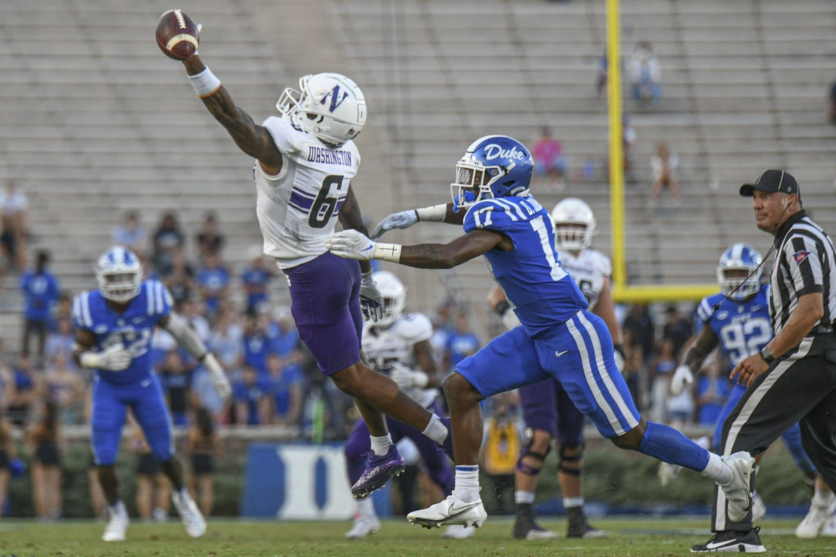 Sep 18, 2021; Durham, North Carolina, USA; Northwestern Wildcats wide receiver Malik Washington (6) reaches for a pass in front of Duke Blue Devils safety Da'Quan Johnson (17) during the third quarter at Wallace Wade Stadium. Mandatory Credit: William Howard-USA TODAY Sports
