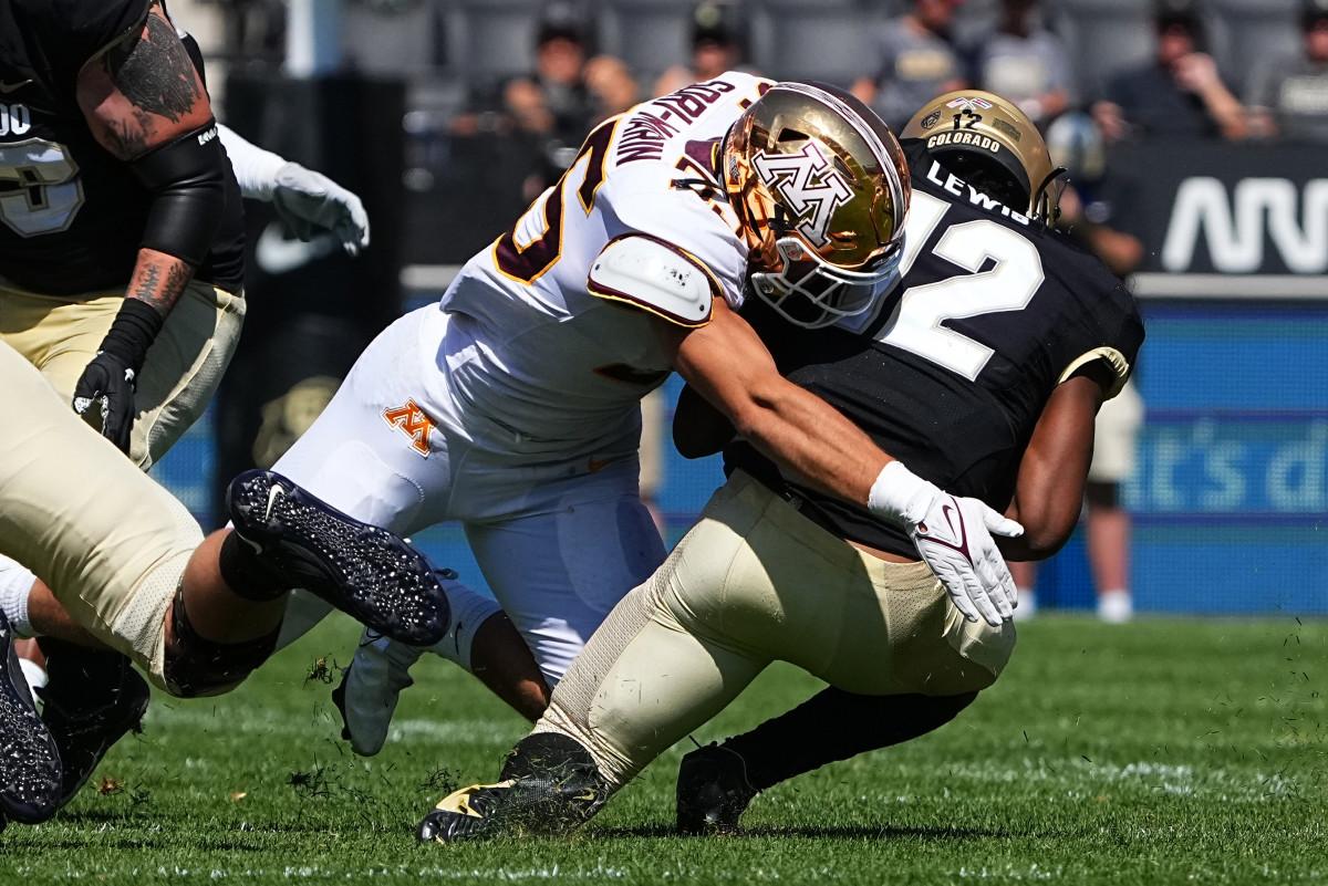 Minnesota linebacker Mariano Sori-Marin (55) tackles Colorado quarterback Brendon Lewis (12).
