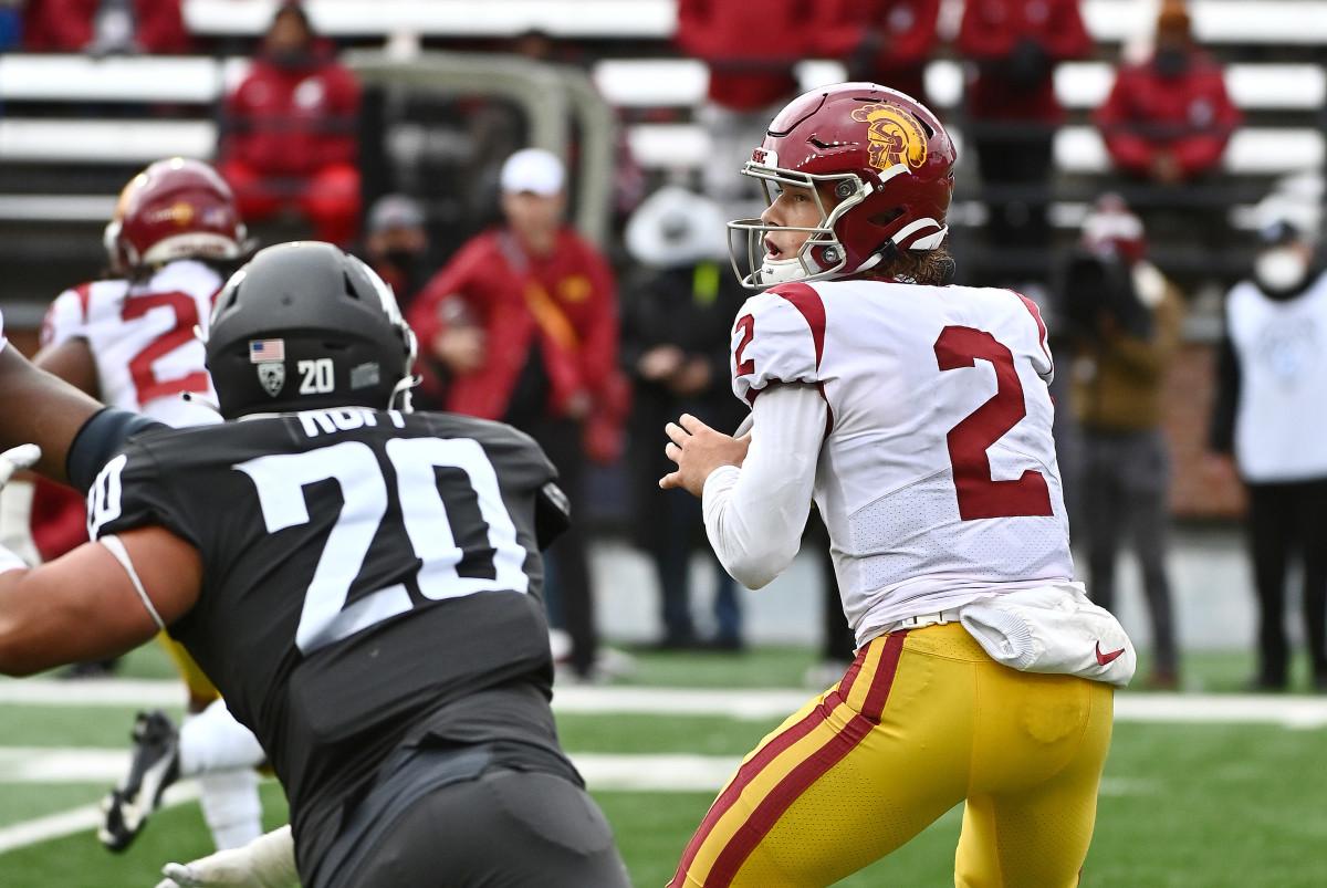 USC Trojans quarterback Jaxson Dart (2) drops back for a pass against the Washington State Cougars.