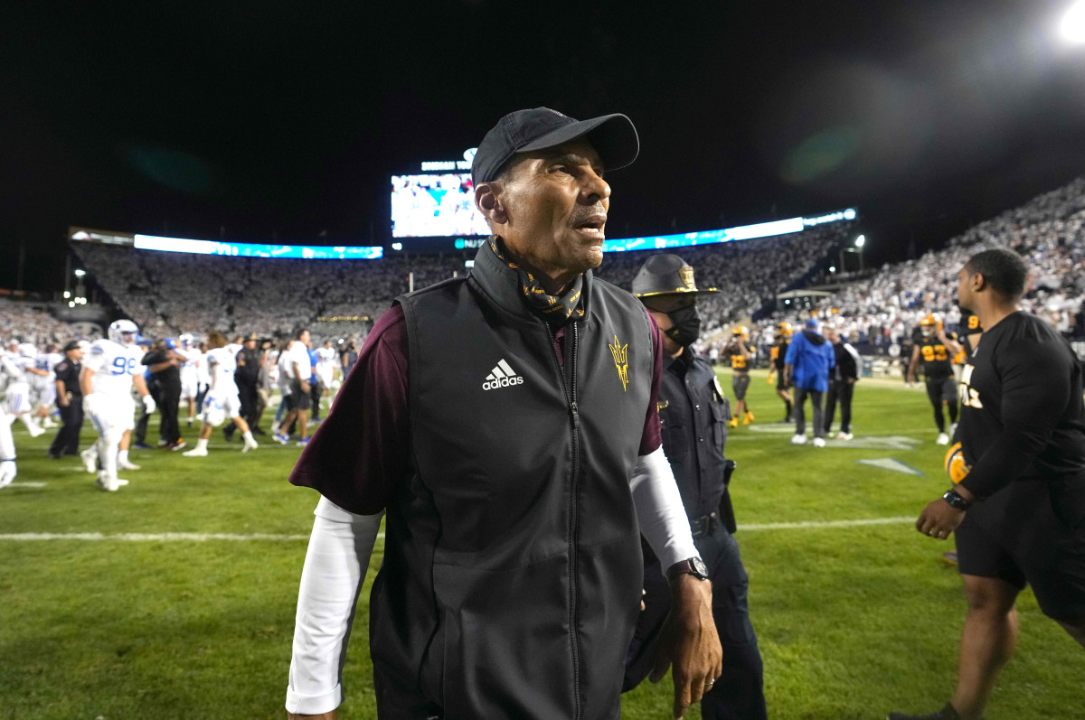 Arizona State Sun Devils head coach Herm Edwards walks off the field after the game against the BYU Cougars.