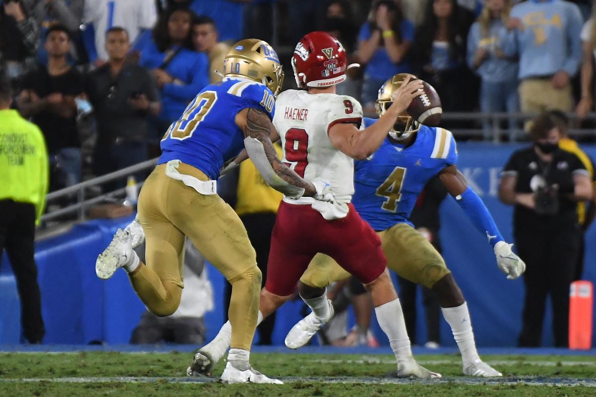 Fresno State Bulldogs quarterback Jake Haener (9) throws a pass as UCLA Bruins linebacker Ale Kaho (10) defends.