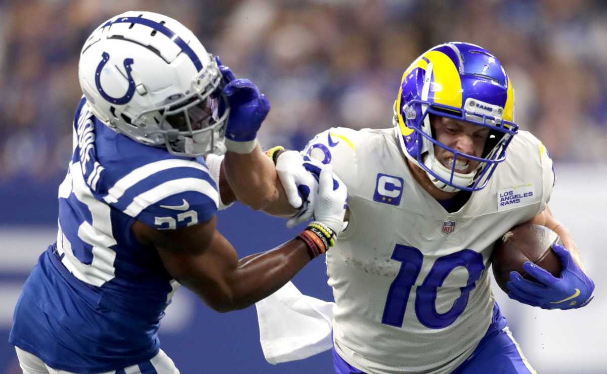 Indianapolis Colts cornerback Kenny Moore II (23) is stiff armed by Los Angeles Rams wide receiver Cooper Kupp (10) as he works to bring him down along the sideline Sunday, Sept. 19, 2021, during a game against the Los Angeles Rams at Lucas Oil Stadium in Indianapolis.