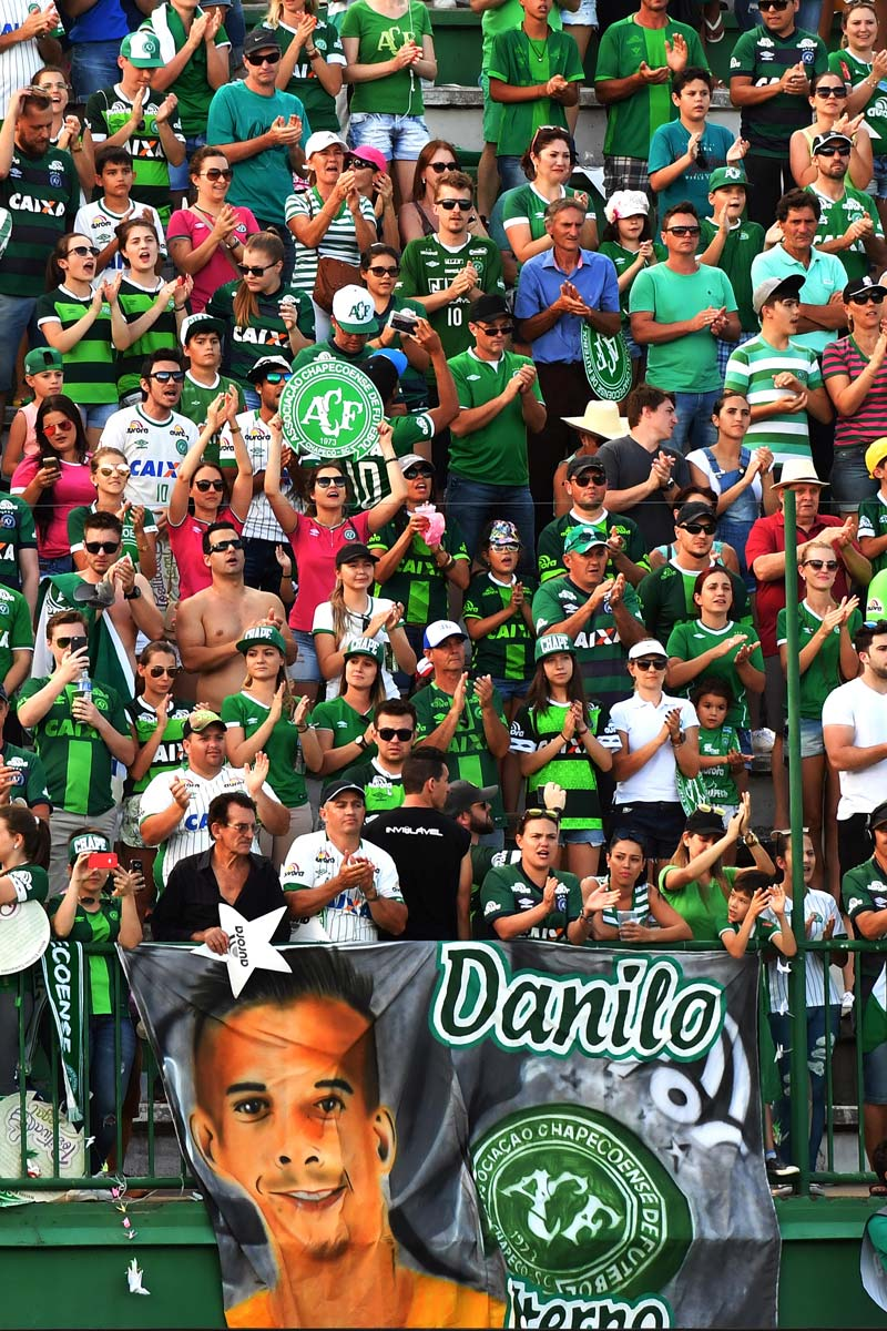 Chapecoense supporters hold up a sign of Danilo during a friendly match against Palmeiras on January 21, 2017.