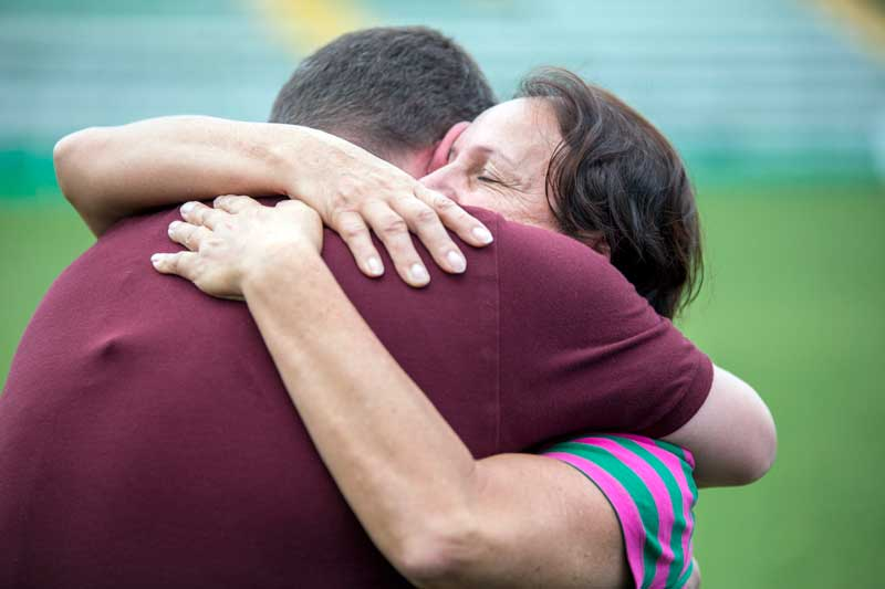 Dona Ilaides (right) embraces reporter Guido Nunes, who lost friends and colleagues aboard Flight 2933.
